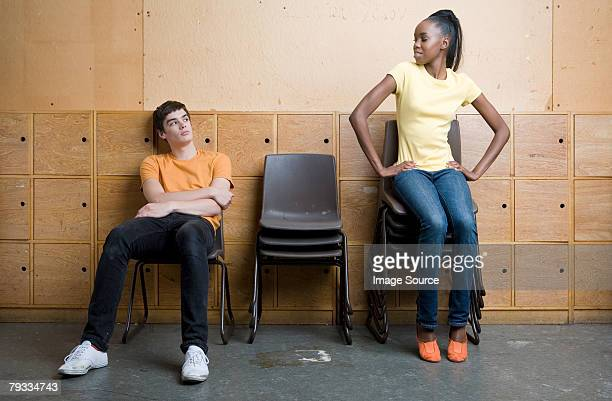 a teenage girl and boy face to face - girl sitting on boys face stock photos and pictures