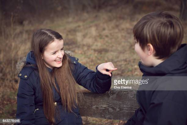 Teenage girl and boy talking together