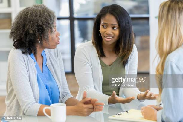 Teenage girl and her mom talk during counseling session