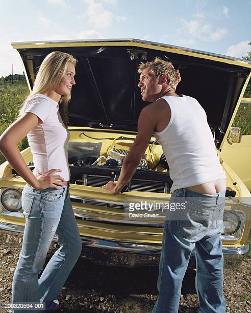teenage girl (15-17) and young man at front of pick-up truck, hood up - builders bum stock pictures, royalty-free photos & images