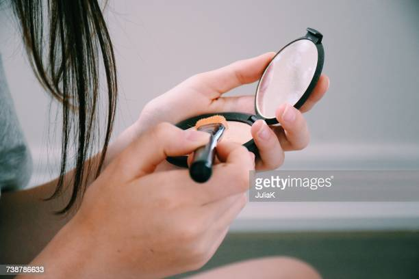 teenage girl applying make-up - midsection stock pictures, royalty-free photos & images