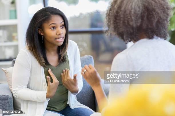 teenage girl argues with mother at home - scolding stock pictures, royalty-free photos & images