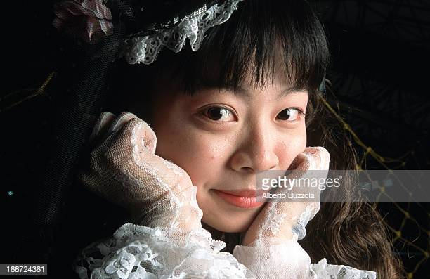 A teenage girl at a 'Cosplay' 'Cosplay' or 'Costume Play' is a Japanese subculture and hobby where participants have fun by dressing up as their...