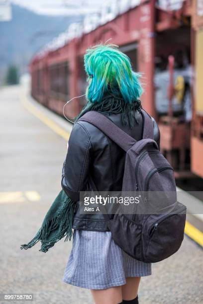 teenage girl at the train station - girl band stock pictures, royalty-free photos & images