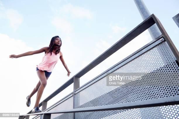 Teenage girl balancing