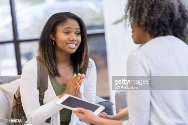 teenage girl begs her mom for permission - permission concept stock pictures, royalty-free photos & images