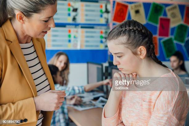teenage girl being bullied teacher consoles - bullying stock pictures, royalty-free photos & images