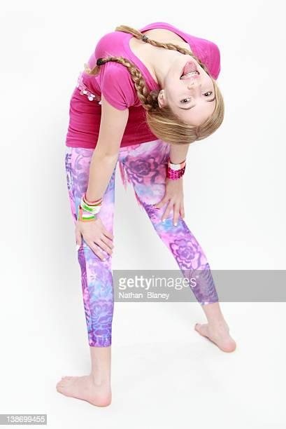 Teenage girl bending over backwards.