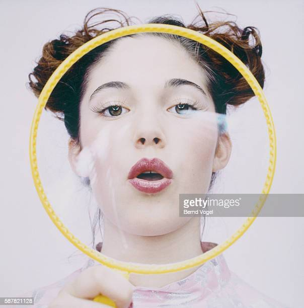 teenage girl blowing bubbles - big lips stock photos and pictures