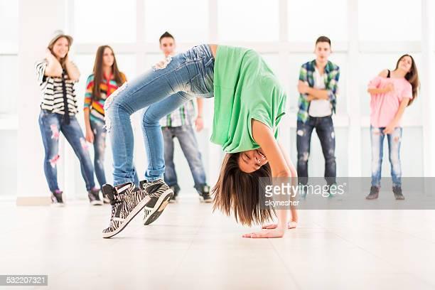 Teenage girl break dancing.