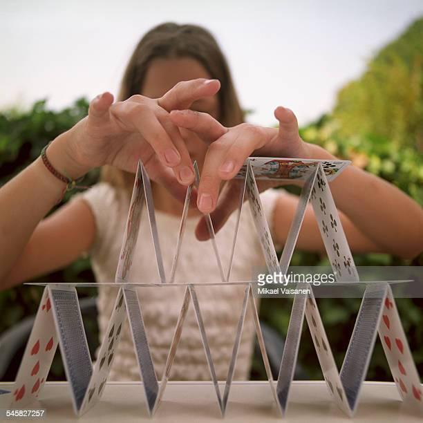 Teenage Girl Building House of Cards