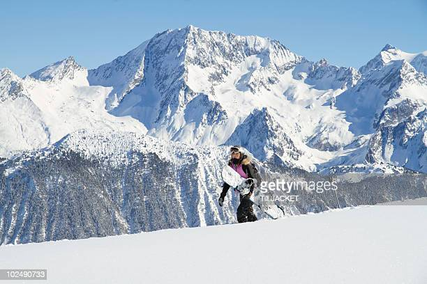 teenage girl carrying snowboard - courchevel stock pictures, royalty-free photos & images