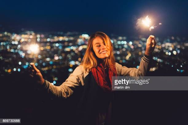 teenage girl celebrating christmas at rooftop terrace - fete stock photos and pictures