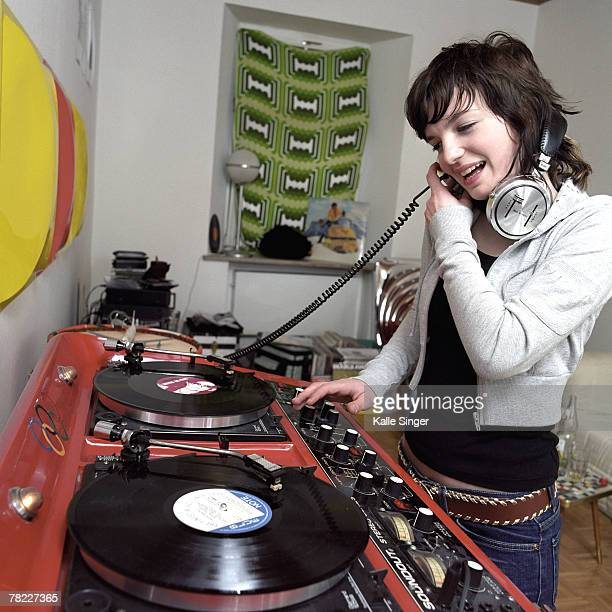 Teenage girl checking record at party