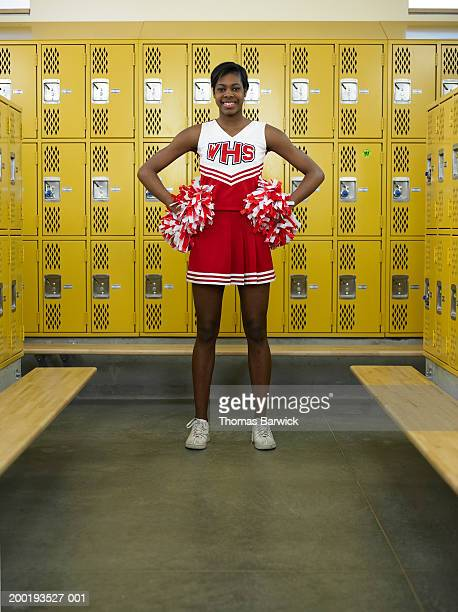 teenage girl (15-17) cheerleader in locker room, portrait - black cheerleaders stock photos and pictures