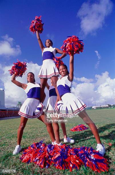 teenage girl cheerleaders (15-18) forming pyramid - black cheerleaders stock photos and pictures