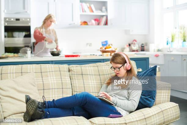 teenage girl chilling at home - sturti stock pictures, royalty-free photos & images