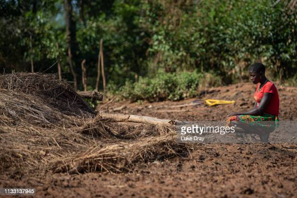 Teenage girl contemplates the remains of her family home on March 26, 2019 in Matara, Mozambique. The home and many others in the village were...