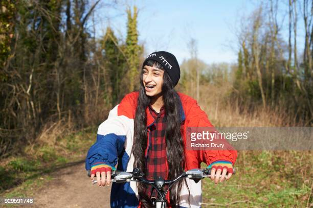 teenage girl cycling on cycle track