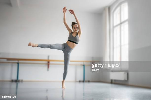 teenage girl dancing ballet in studio