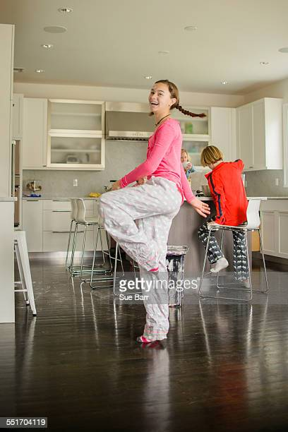 Teenage girl dancing in kitchen