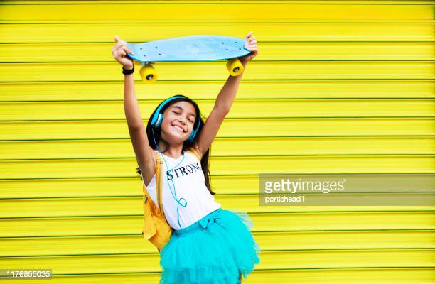 teenage girl dancing to the music - pre adolescent child stock pictures, royalty-free photos & images
