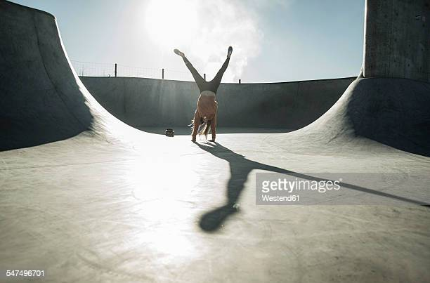 teenage girl doing a cartwheel in skatepark - handstand stock pictures, royalty-free photos & images