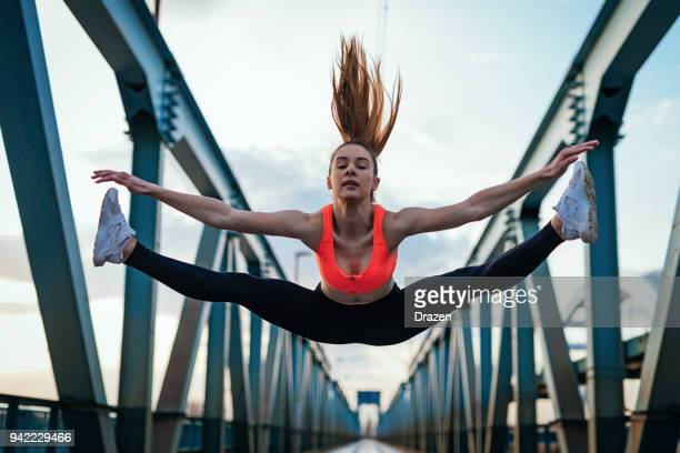 teenage girl doing splits in the air - doing the splits stock photos and pictures
