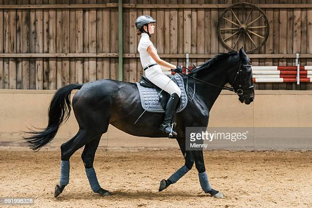 teenage girl dressage riding equestrian hall - dressage stock pictures, royalty-free photos & images