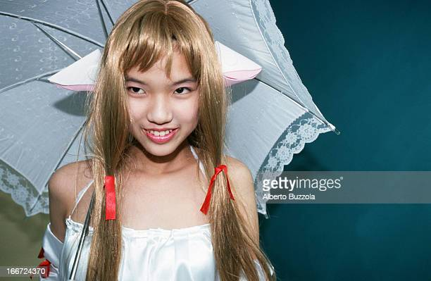 A teenage girl dressed in a costume of a modern Japanese comic character at a 'Cosplay' 'Cosplay' or 'Costume Play' is a Japanese subculture and...