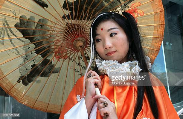 A teenage girl dressed in a costume of a modern Japanese comic character poses at a 'Cosplay' 'Cosplay' or 'Costume Play' is a Japanese subculture...