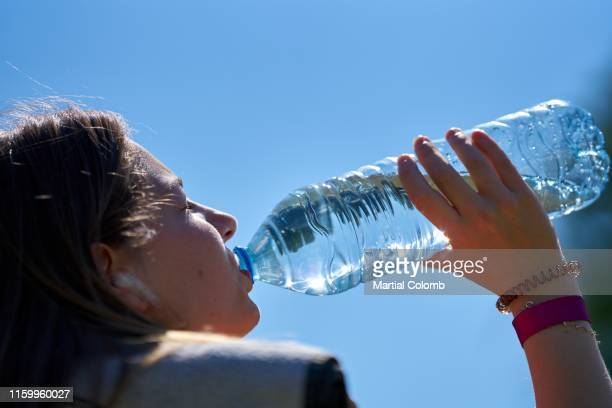 teenage girl drinking after an effort - martial stock pictures, royalty-free photos & images