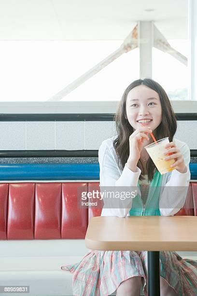 teenage girl drinking juice - teenagers only stock pictures, royalty-free photos & images