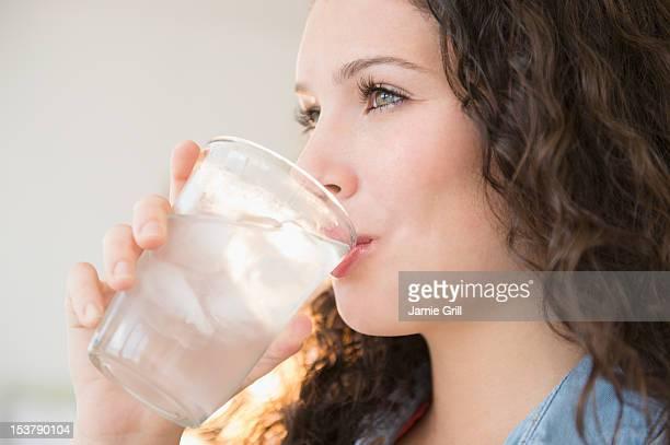 Teenage girl drinking water