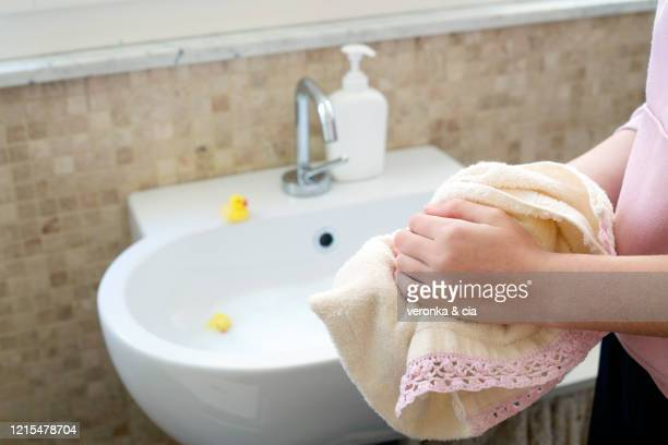 a teenage girl drying her hands - drying stock pictures, royalty-free photos & images
