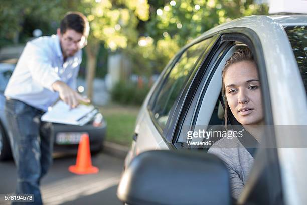 Teenage girl during driving license test