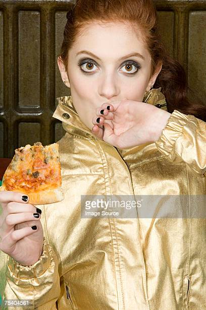 teenage girl eating pizza - gold jacket stock pictures, royalty-free photos & images