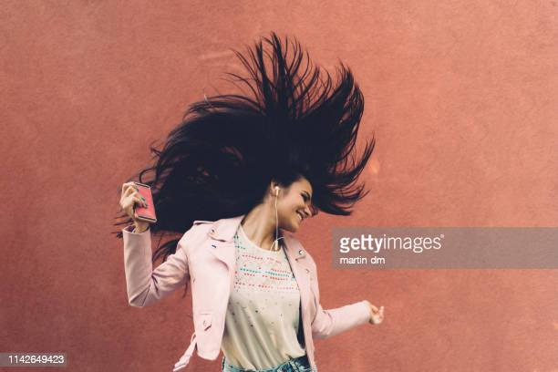 teenage girl enjoying disco music - beautiful people stock pictures, royalty-free photos & images