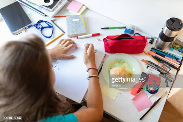 teenage girl erasing mistake in homework - pencil case stock photos and pictures