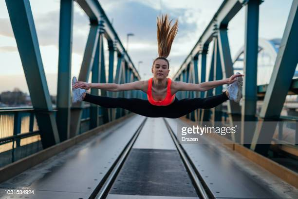 teenage girl exercising and doing splits - doing the splits stock pictures, royalty-free photos & images