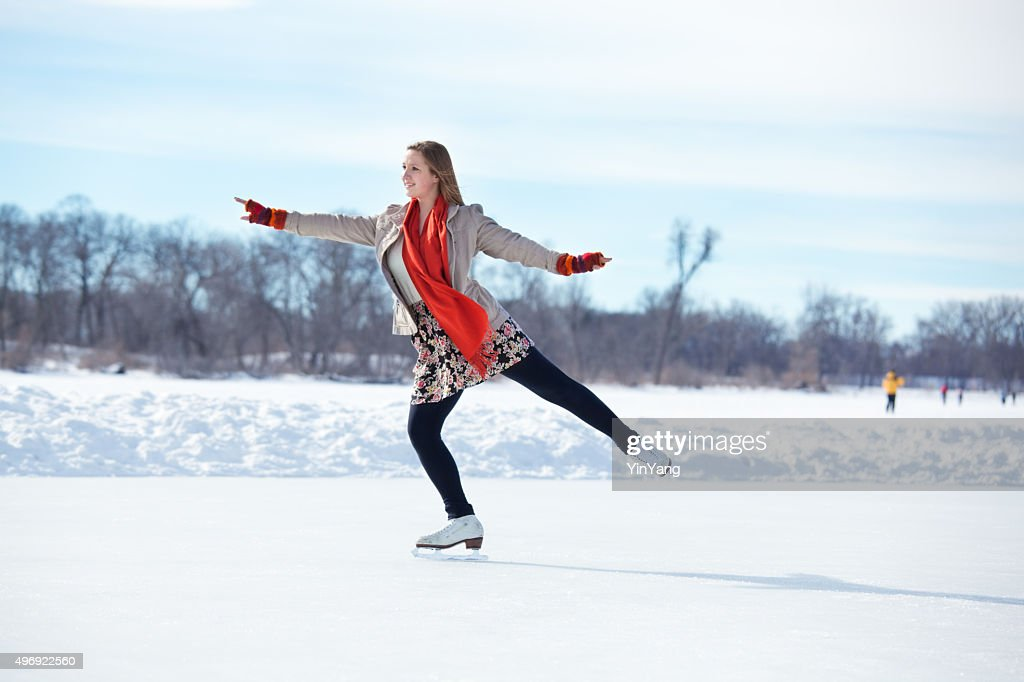 teenage girl figure skating on winter lake ice rink