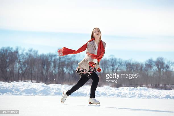 teenage girl figure skating on winter lake ice rink, minneapolis - ice skate stock pictures, royalty-free photos & images