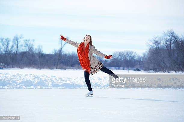 teenage girl figure skating on winter lake ice rink, minneapolis - ice rink stock photos and pictures