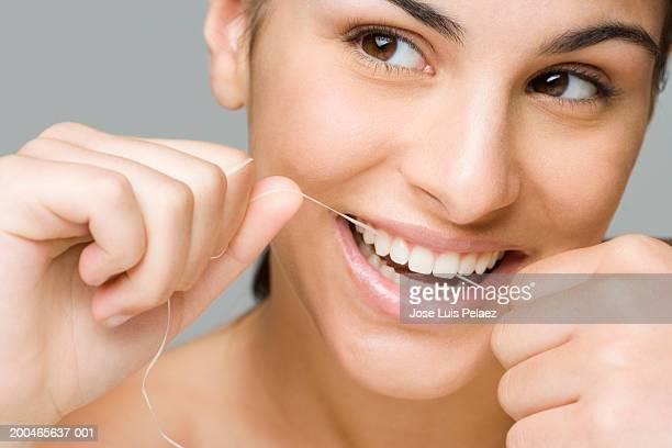 Teenage girl (14-16) flossing, close-up