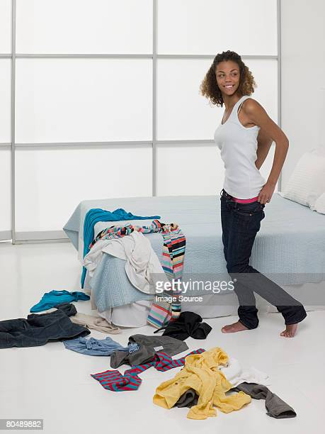A teenage girl getting dressed