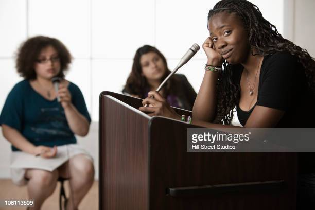 teenage girl giving speech to classmates - debate stock pictures, royalty-free photos & images