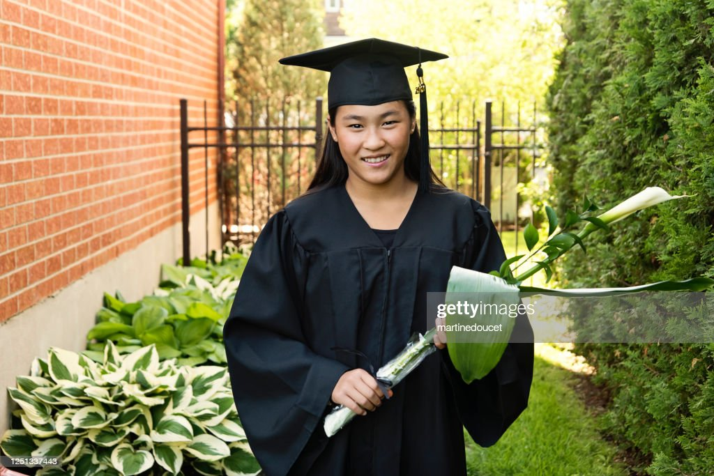 Teenage girl graduation from primary school portrait in backyard. : Stock Photo