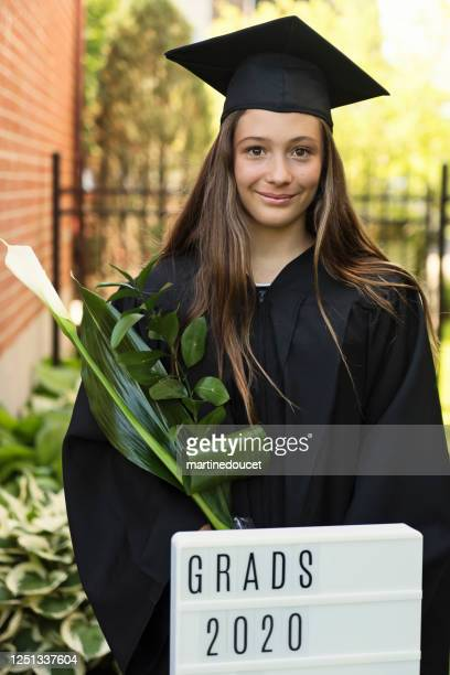 """teenage girl graduation from primary school portrait in backyard. - """"martine doucet"""" or martinedoucet stock pictures, royalty-free photos & images"""