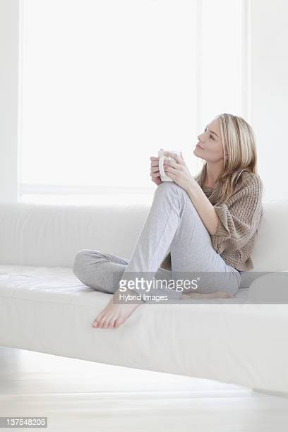Teenage girl having cup of coffee