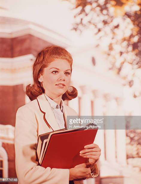 Teenage girl high school student carrying books. (Photo by H. Armstrong Roberts/Retrofile/Getty Images)